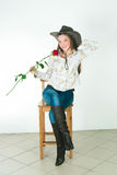 The girl with a rose in a cowboy's hat Royalty Free Stock Photos