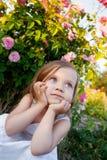 Girl in rose garden Stock Photos