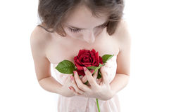Girl with a rose in hands Stock Image