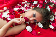 Girl in rose petal Royalty Free Stock Images