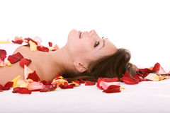 Girl in rose petal. Spa resort. Beautiful girl in rose petal. Spa resort Royalty Free Stock Photos
