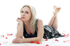 Girl in rose petals royalty free stock images