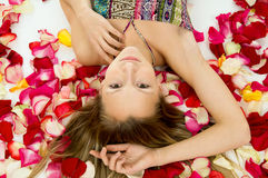 Girl with rose petals Stock Photography