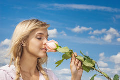 Girl with rose. Young beautiful woman with rose flower Stock Photography