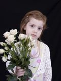 Girl with Roses. Four year old girl holding roses Royalty Free Stock Image