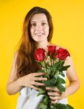 Girl with roses  over yellow Stock Photo