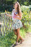 Girl in roses plant at garden Stock Images