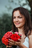 Girl with roses. Portrait of a girl with beautiful flowers roses Stock Image