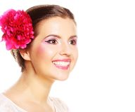 Girl with rosy peony on the head Royalty Free Stock Photography