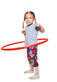 The girl rotates a gymnastic hoop Stock Image
