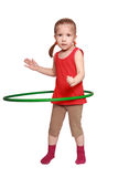 The girl rotates a gymnastic hoop Royalty Free Stock Images
