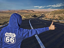 Girl on route 66. Girl trying to catch a car on route 66 empty road Royalty Free Stock Photography