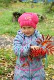 Girl with rowan berries Stock Image