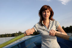 Girl Rowing A Boat Stock Photography