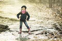 Girl in rubber boots in the autumn forest Stock Image