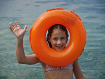 Girl with rubber ring. The girl holding rubber ring on the head stock image