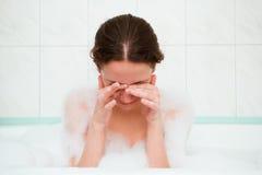 Girl rubbing her eyes Royalty Free Stock Photos