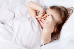 Girl rubbing her eyes Royalty Free Stock Photo