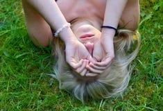 Girl rubbing her eyes Royalty Free Stock Image