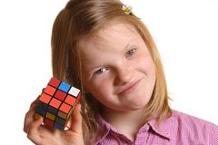 Girl with Rubik's cube Royalty Free Stock Photography
