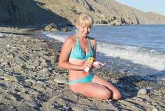 Girl rubs cream sunburn Stock Photo