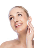 Girl rubs face cream Royalty Free Stock Image