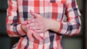 Girl rubs hand cream in her fingers