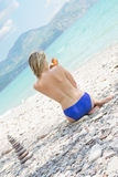 Girl rubs sunscreen Royalty Free Stock Photo