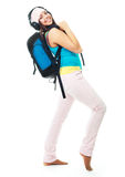 Girl with a rucksack. Happy young beautiful student with a rucksack wearing earphones Stock Photos