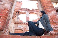 Girl in the ruined brick house Royalty Free Stock Image