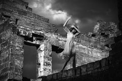 Girl in the ruined building Royalty Free Stock Photo