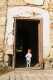 Girl at Ruined House Royalty Free Stock Photos