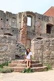 Girl in ruins of castle Pecka Royalty Free Stock Photography
