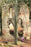 Girl by ruins of the chapel of St. Mary Magdalene. Young smiling woman standing near by ruins of the chapel of St. Mary Magdalene on hill Small Blanik in Czech royalty free stock image