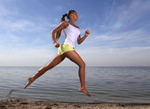 Girl run on beach Stock Photos