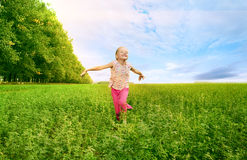 Girl run on green field Royalty Free Stock Photography