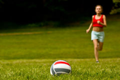 Girl run for volleyball ball Stock Photo