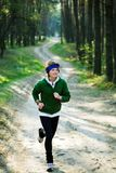 Girl runner in the forest Stock Photo