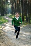 Girl runner in the forest Stock Images