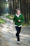Girl runner in the forest Stock Photos