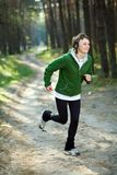 Girl runner in the forest Royalty Free Stock Image