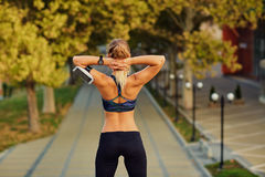 Girl runner before jogging at the entrance of park in the summer Royalty Free Stock Image