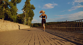 Girl runner jogging in the park on road.  stock image
