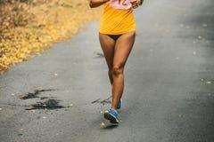 Girl runner is running marathon Royalty Free Stock Photography