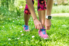 Girl runner tying running shoe summer weight loss Stock Photo