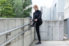 Girl runner tying a shoe Stock Photos