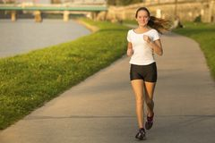 Girl runner in the urban environment. Royalty Free Stock Photography