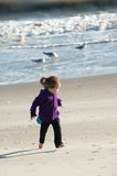 Girl running. At the beach Stock Photography