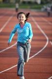 Girl running. Chinese little girl running in stadium Royalty Free Stock Photos