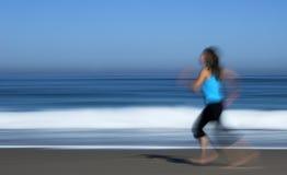 Girl running. Motion effect of girl running in the beach stock photo